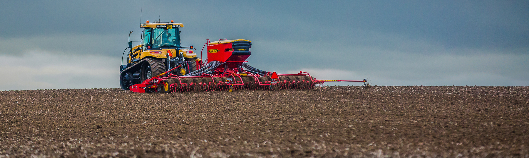 Väderstad Seed drill Rapid A in field under stormy clouds